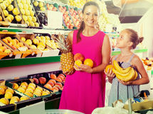 Woman with child buying fruits Stock Photo