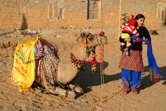 Woman, child and a camel Royalty Free Stock Photos
