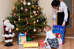 Woman and child with Christmas tree Royalty Free Stock Photography