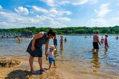 Woman and child close by the water. stock photo