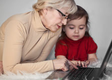 The woman with the child at the computer Royalty Free Stock Images