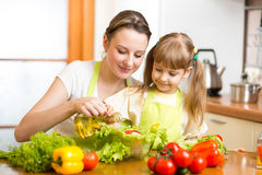 Woman with child cook at kitchen Royalty Free Stock Image