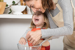 Woman and child cooking and laughing Royalty Free Stock Photo