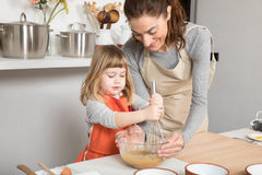 Woman and child cooking whipping in bowl Royalty Free Stock Images