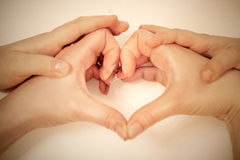 Woman and child create hands of the heart Royalty Free Stock Photos