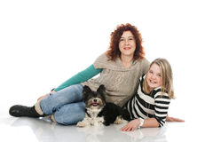 Woman and child with dog Stock Photography