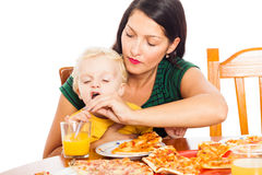 Woman with child drinking juice Stock Photos
