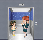 A woman and a child at the elevator Stock Photography