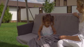 Woman and child enjoy summer at backyard house. stock video