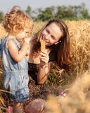 Woman with child in field. Of wheat stock image