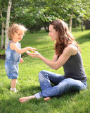 Woman with child having fun. In summer park royalty free stock photography