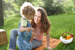Woman with child having fun. Happy family having picnic in summer park royalty free stock images