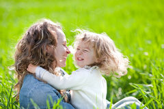Woman and child having fun. Happy family having fun in summer field stock photos