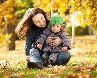 Woman with child having fun in autumn Royalty Free Stock Photo