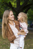 Woman with child having fun in park Stock Images