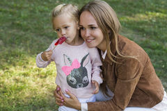Woman with child having fun in park Royalty Free Stock Images