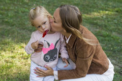 Woman with child having fun in park Royalty Free Stock Photos