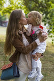Woman with child having fun in park Royalty Free Stock Photo
