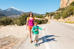 Woman with a child hitchhiking royalty free stock photo