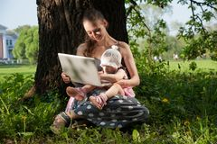Woman with child and laptop Stock Photos