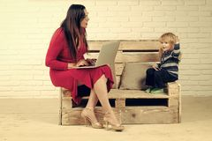 Woman and child with laptop, inclusive education. Small boy and teacher girl in glasses, blogging. School and communication. Social network and new technology Royalty Free Stock Photography