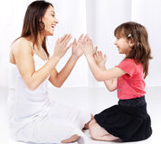 Woman and child laughing and playing Stock Image