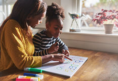 Woman and child learning alphabet stock image