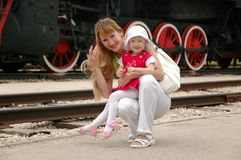 Woman and child beside locomotive Stock Photography