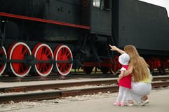 Woman and child look at locomotive Royalty Free Stock Photos