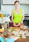 Woman with a child making fish dumplings freshest salmon stuffi Royalty Free Stock Photo