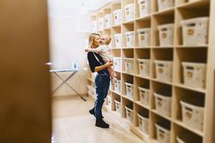 Woman with a child near the shelf with baskets royalty free stock photos