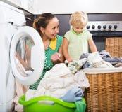 Woman with child near washing machine Royalty Free Stock Photos