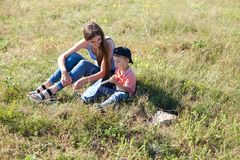 Mom with son catch butterflies in the Park NET. A women with a child on an outing with German Shepherd training royalty free stock photography