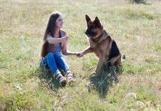 A woman with a child with German Shepherd training. A woman with a child on an outing with German Shepherd training royalty free stock image