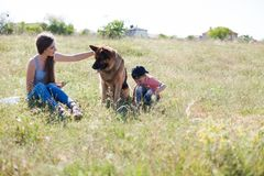 A woman with a child with German Shepherd training. A women with a child on an outing with German Shepherd training royalty free stock images