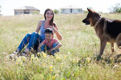 A woman with a child with German Shepherd training. A women with a child on an outing with German Shepherd training royalty free stock image