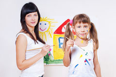 Woman and child paint colors stock photos