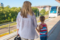 Woman with a child on the platform waiting train Royalty Free Stock Images