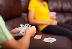 Woman and child playing cards Stock Photography