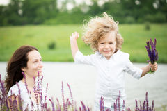 Woman and child playing outdoors Stock Photos