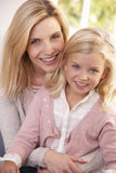 Woman and child pose in studio Stock Photography