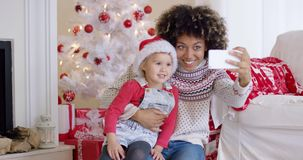 Woman and child posing for camera phone stock video