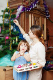 Woman and child preparing for Christmas Royalty Free Stock Photo