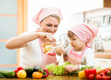 Woman and child preparing healthy food together Stock Images