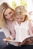 Woman and child reading together Royalty Free Stock Image