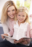 Woman and child reading together Stock Photo