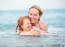Woman and child in red sea Stock Image
