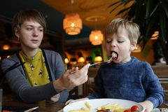 Woman and child in restaurant Royalty Free Stock Photo