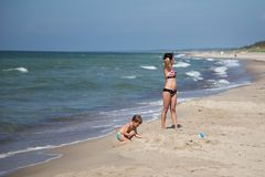 Woman and child rests at Baltic beach. stock photography