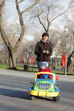 Woman with child riding car Royalty Free Stock Photos